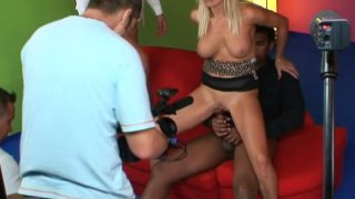 Smiling blondie Winnie pleases black and white dudes on camera