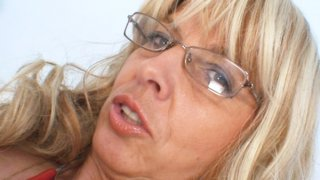 Old Milf wears glasses and toys herself with a stethoscope